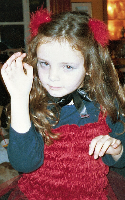 a young me dressed up for Halloween